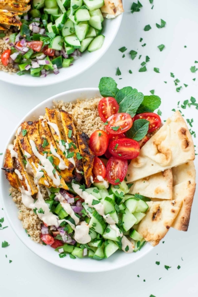 Chicken Shawarma Quinoa Bowls with a super easy hack for creating make-ahead lunches for work or school. The flavors are out of this world!!