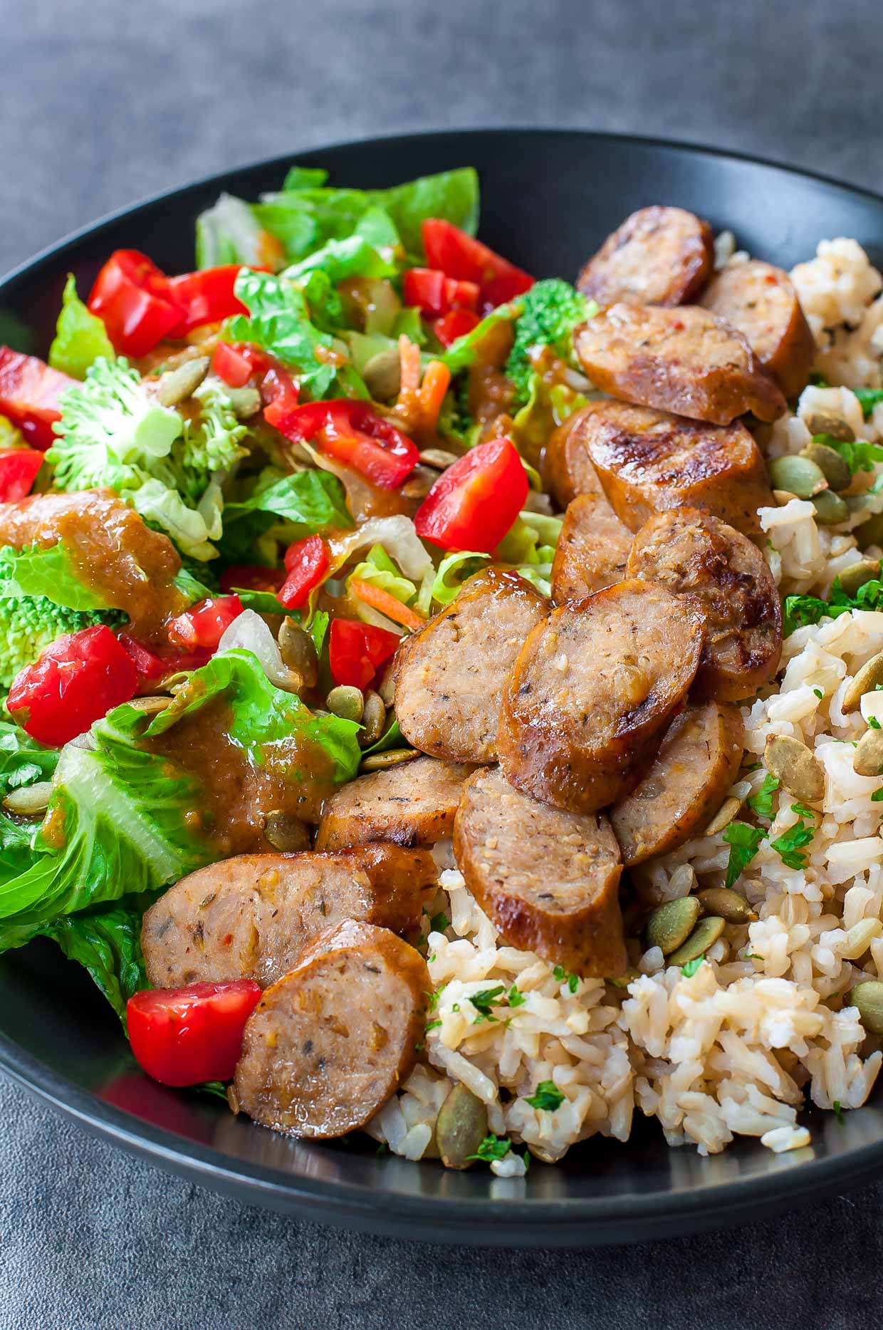 These fuss-free Sausage and Veggie Rice Bowls make a quick and easy lunch or dinner! Gluten-free with vegan, vegetarian, and paleo options - heck yes!