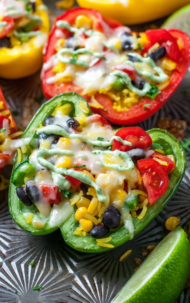 These Cheesy Southwest Stuffed Peppers with Cilantro Avocado Sauce prove that vegetarian eats can be tasty and filling!