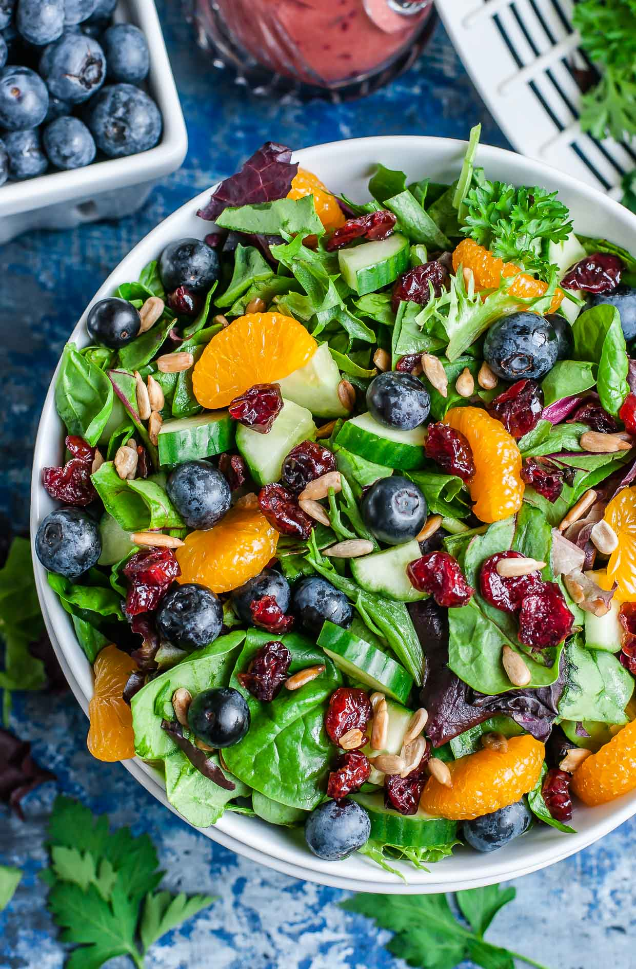 I'm head over heels in LOVE with this healthy Cranberry Blueberry Spring Mix Salad with Blueberry Balsamic Dressing! This scrumptious Summer salad is fun, fruity, and full of flavor!
