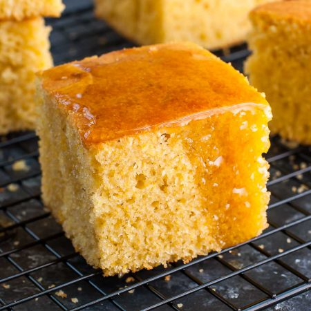 Curb those comfort food cravings with a pan of this quick and easy homemade cornbread! This my absolute favorite recipe for fluffy and flavorful cornbread, perfect for dunking in a big bowl of chili!