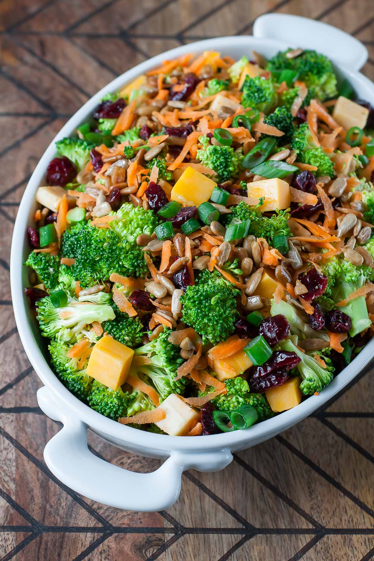 Classic Broccoli Salad with cranberries, carrots, and tasty lightened-up homemade dressing.