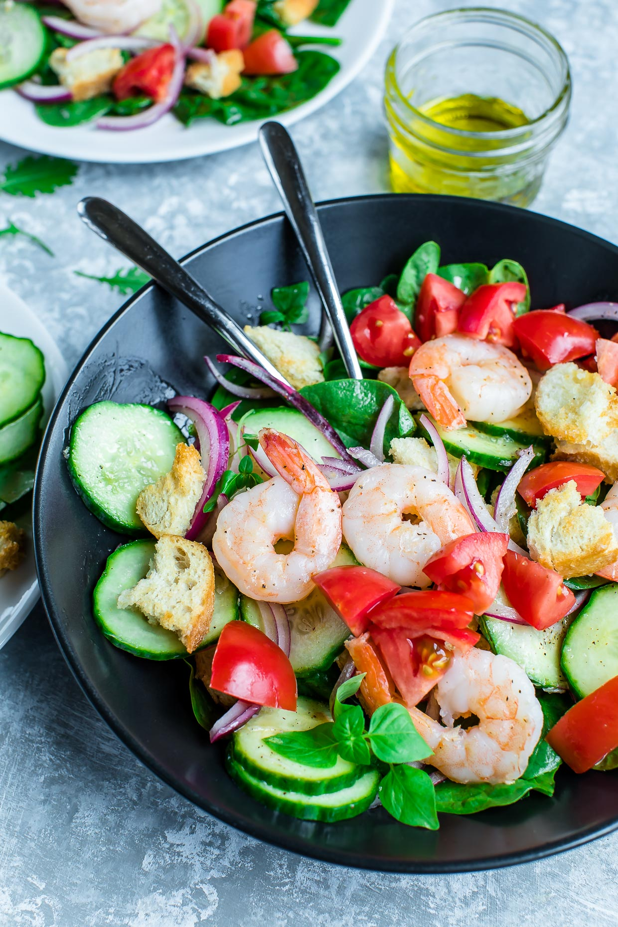 Shrimp Panzanella Spinach Salad is a tasty twist on the classic Tuscan bread salad. Light, healthy, and totally delicious!