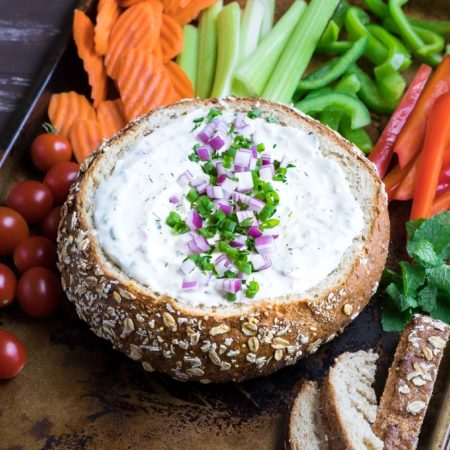 This party-perfect Chilled Veggie Dip is served in a bread bowl with crunchy veggies for a tasty snack that will have your guests coming back for more!