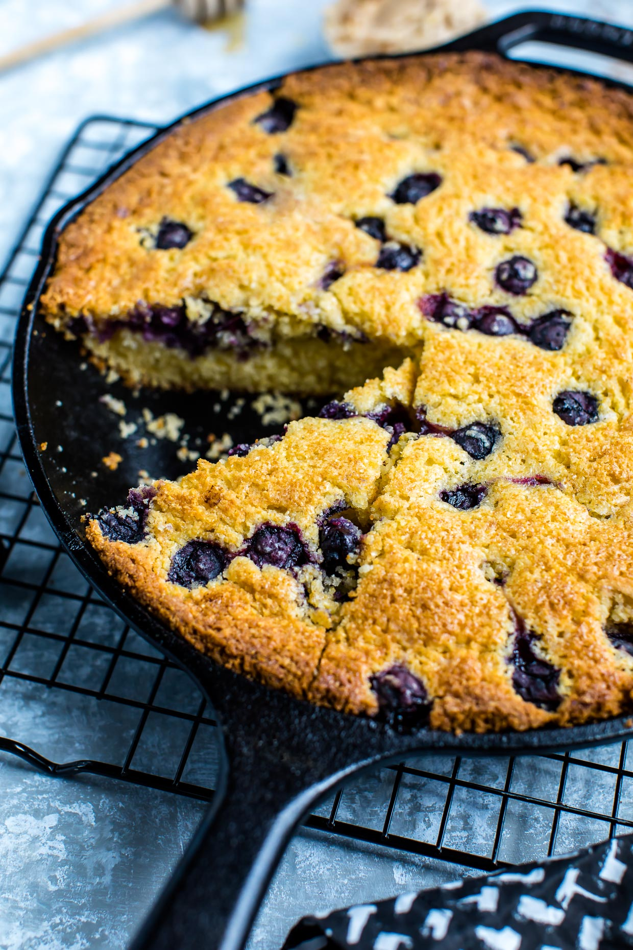 Sweet Blueberry Cornbread Skillet with Cinnamon Honey Butter kissed withsavory sweetness and baked to fluffy perfection. This cast iron skillet cornbread is totally delicious!