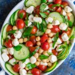 We're crazy for this Tomato Mozzarella Chickpea Salad. This quick and easy dish is full of flavor and a breeze to toss together!