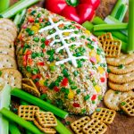 You're guaranteed touchdown status at your next game day party with this Buffalo Ranch Football Cheese Ball! This crazy easy appetizer can be made in advance and is portable and DELICIOUS!