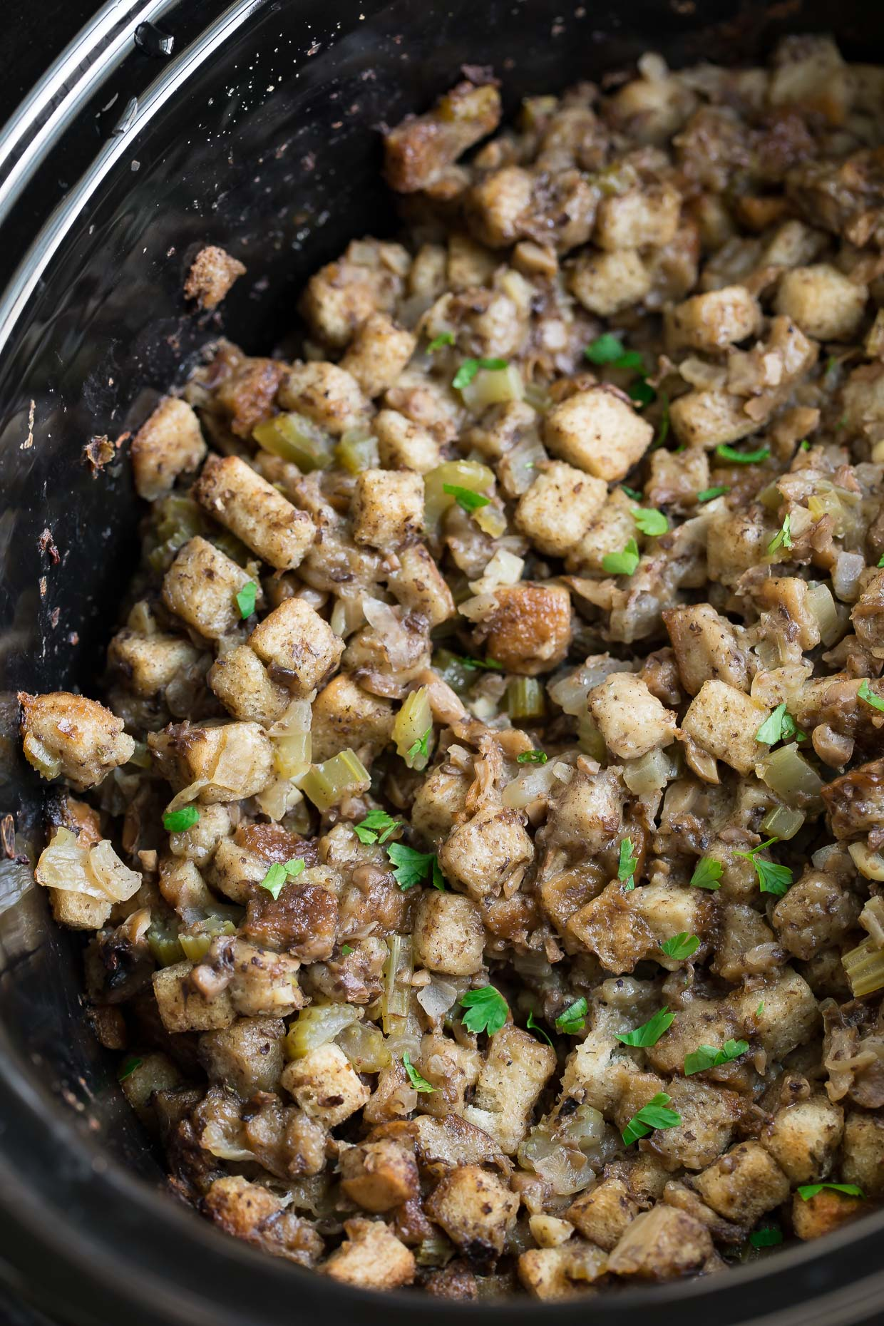 Save precious oven space with this classic Slow Cooker Stuffing recipe! Since converting my mom's Thanksgiving stuffing to the crock-pot I've been OBSESSED with the results. It comes out perfectly tender on the inside and crisp on the outside!