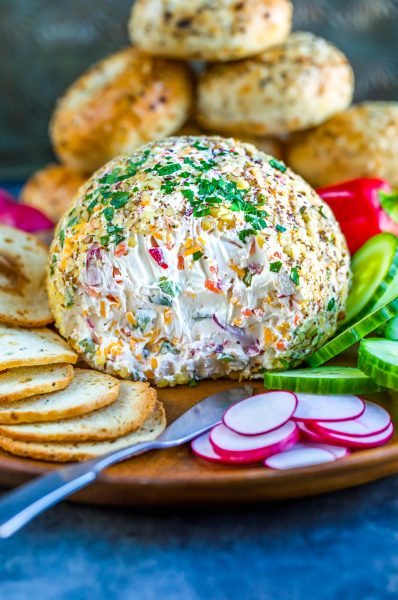 A super fun way to serve bagels and cream cheese, this Veggie Cream Cheese Breakfast Cheese Ball will jazz up your brunch game with little effort! This tasty veggie-packed cream cheese can be made the night before for a make-your-own-bagel spread for family and friends!