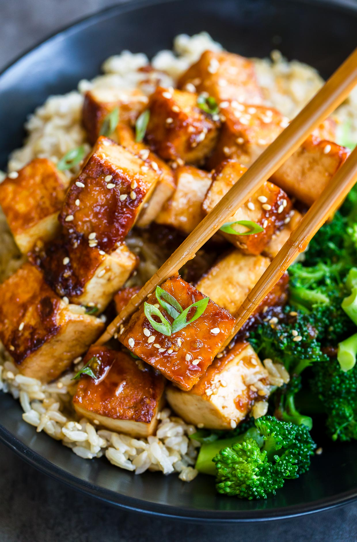 Honey Garlic Tofu with broccoli and chopsticks