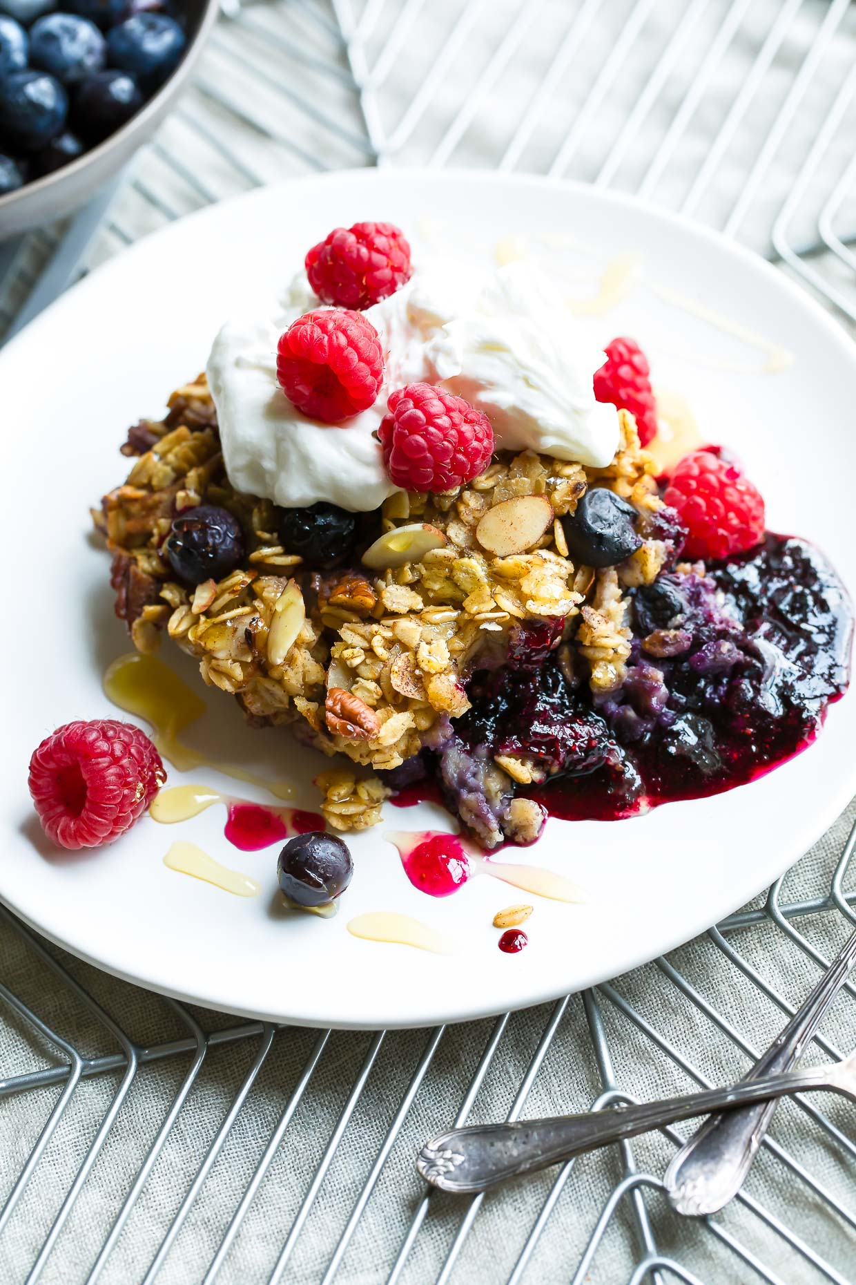 Blueberry Baked Oatmeal with Whipped Cream and Berries