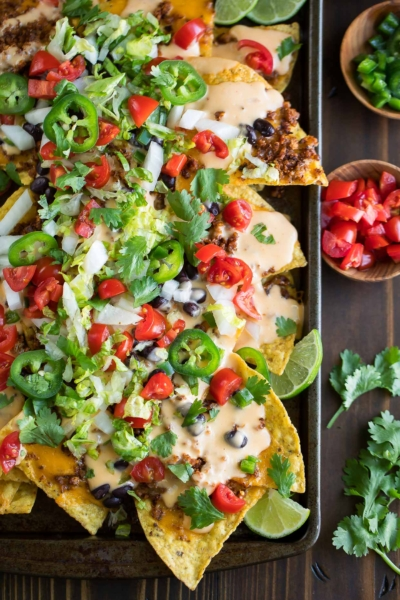 sheet pan nachos topped with queso