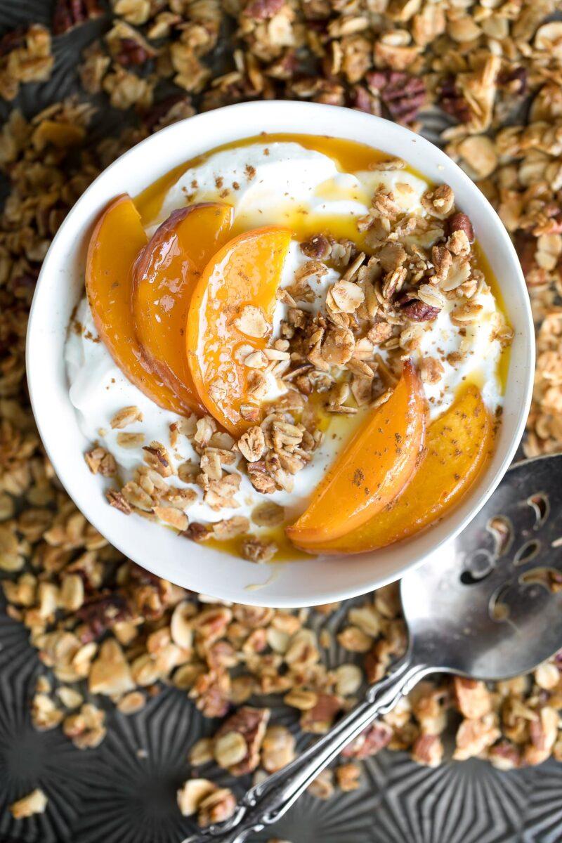 Roasted Peach Yogurt Bowl with Cinnamon and Granola