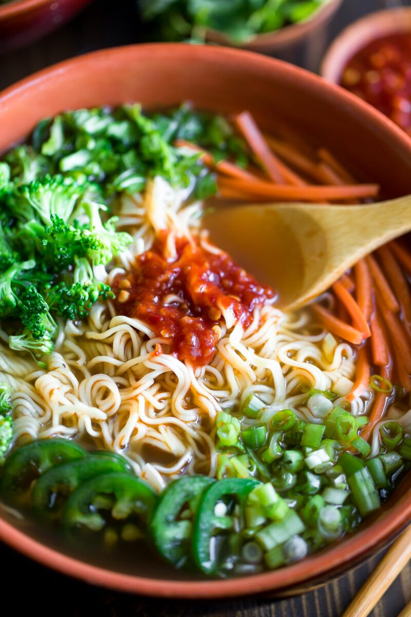 Ramen Noodle Soup Bowl with Broccoli, Jalapeños, Scallions, Bok Choy, Carrots, and Chili Garlic Sauce
