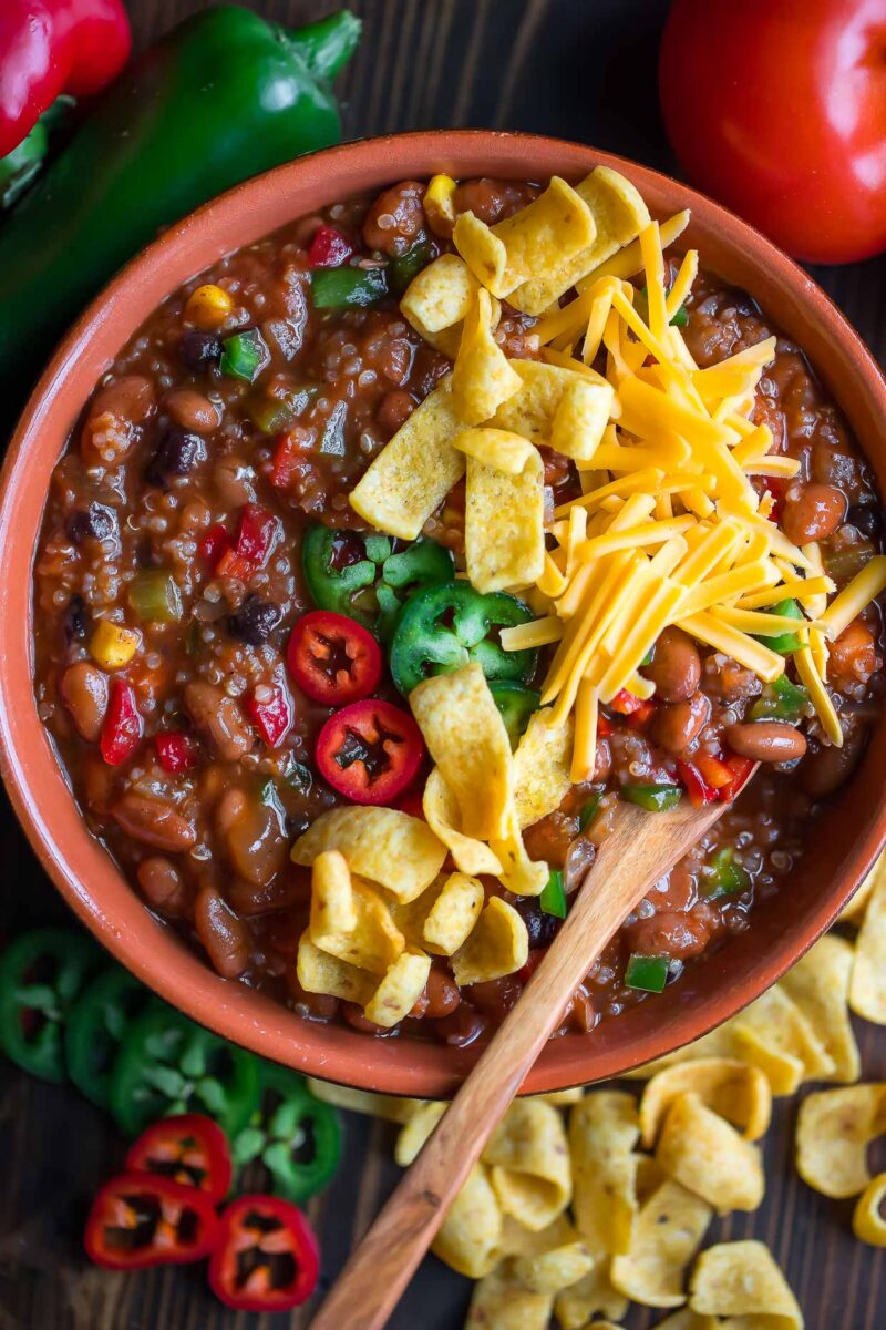 Veggie Quinoa Chili Bowl with Fritos, Jalapeños, and Cheese toppings